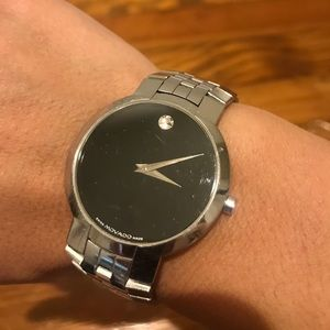 Movado Silver watch with black face